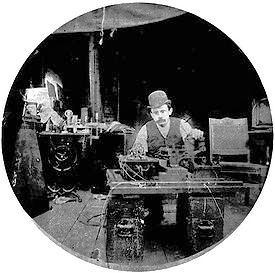 Charles H. Kayser with Edison's first motion picture camera,