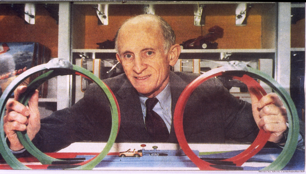 Photo of Jerry Lemelson with toy car track