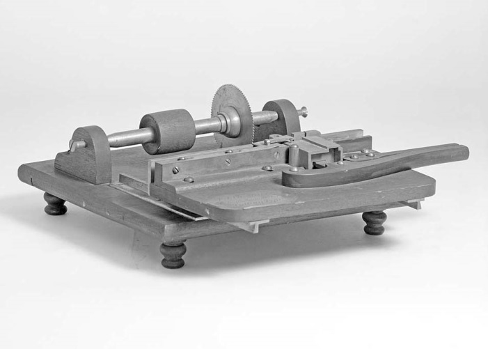 "John Joseph Charles Smith patent model for a ""machine for cutting printers type."""