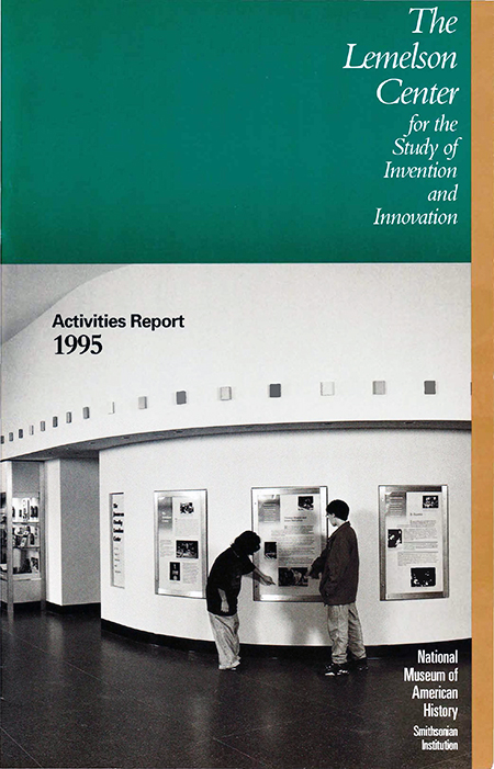 Cover of report booklet, showing two people looking at exhibition posters.