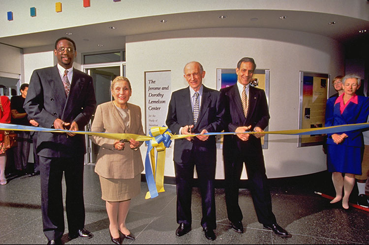 Four people cutting a ceremonial ribbon