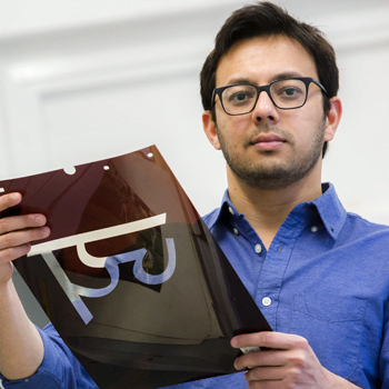 2017 Lemelson Fellow Vaibhav Singh. He is holding a sample of a Hindi typeface.