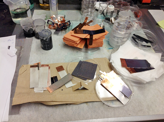 """Some components of Prieto's prototype battery, June 2012. Rectangles of copper """"foam"""" are top center."""