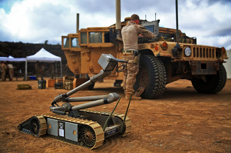 Autonomous Multifunctional Robot with a soldier by a Jeep in the background
