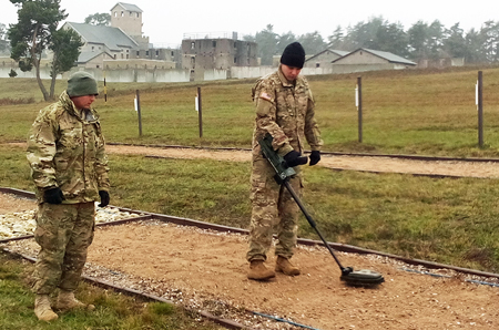 Two soldiers operating ground penetrating radar for mine detection