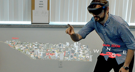 Researcher interacting with a 3-D augmented reality model of a city