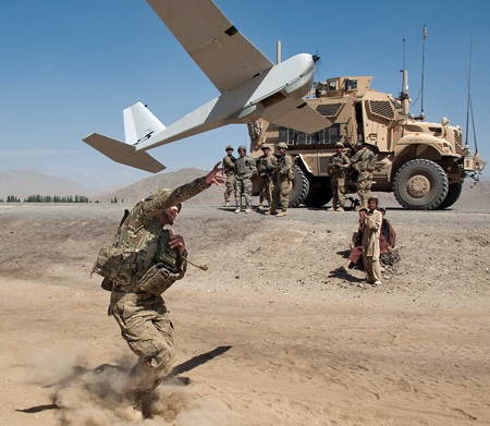 Soldier launching a PUMA Unmanned Aerial Vehicle