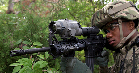 Soldier aiming rifle equipped with thermal weapon sight
