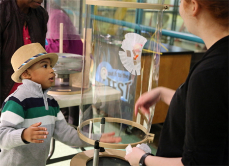 Young boy working on the Build and Test an Aerial Vehicle activity at Spark!Lab.