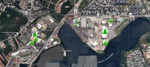 An overhead view of the northwest section of the Lagoa de Jacarepaguá area in Rio de Janeiro. Some buildings are marked with grey or green nuclear symbols and head-and-shoulders outlines of people, simulating the tracking of sensors.
