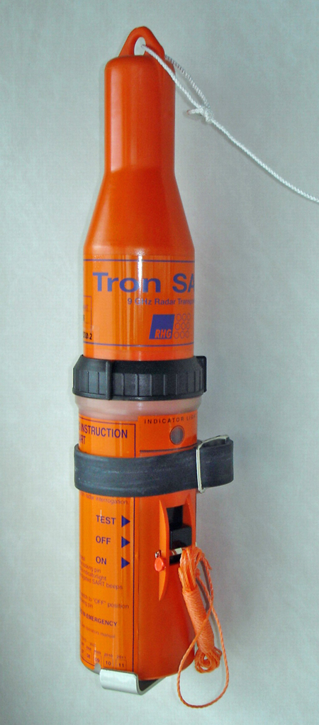 The orange search and rescue transponder is approximately an eight inch conical shape with an on / off switch on the side.