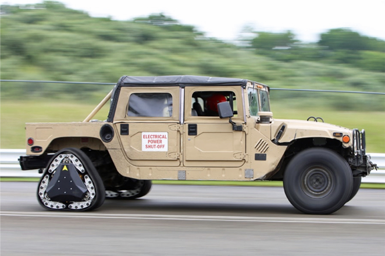 A Jeep-like Army vehicle drives with a rear wheel that can be configured either in a typical round shape or one that shifts in two seconds to a triangular shape that gives the vehicle traction on uneven terrain.