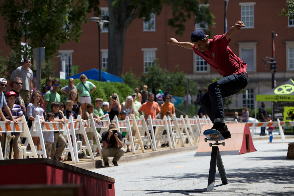 Skateboarder David Loy grinding a rail at Innoskate