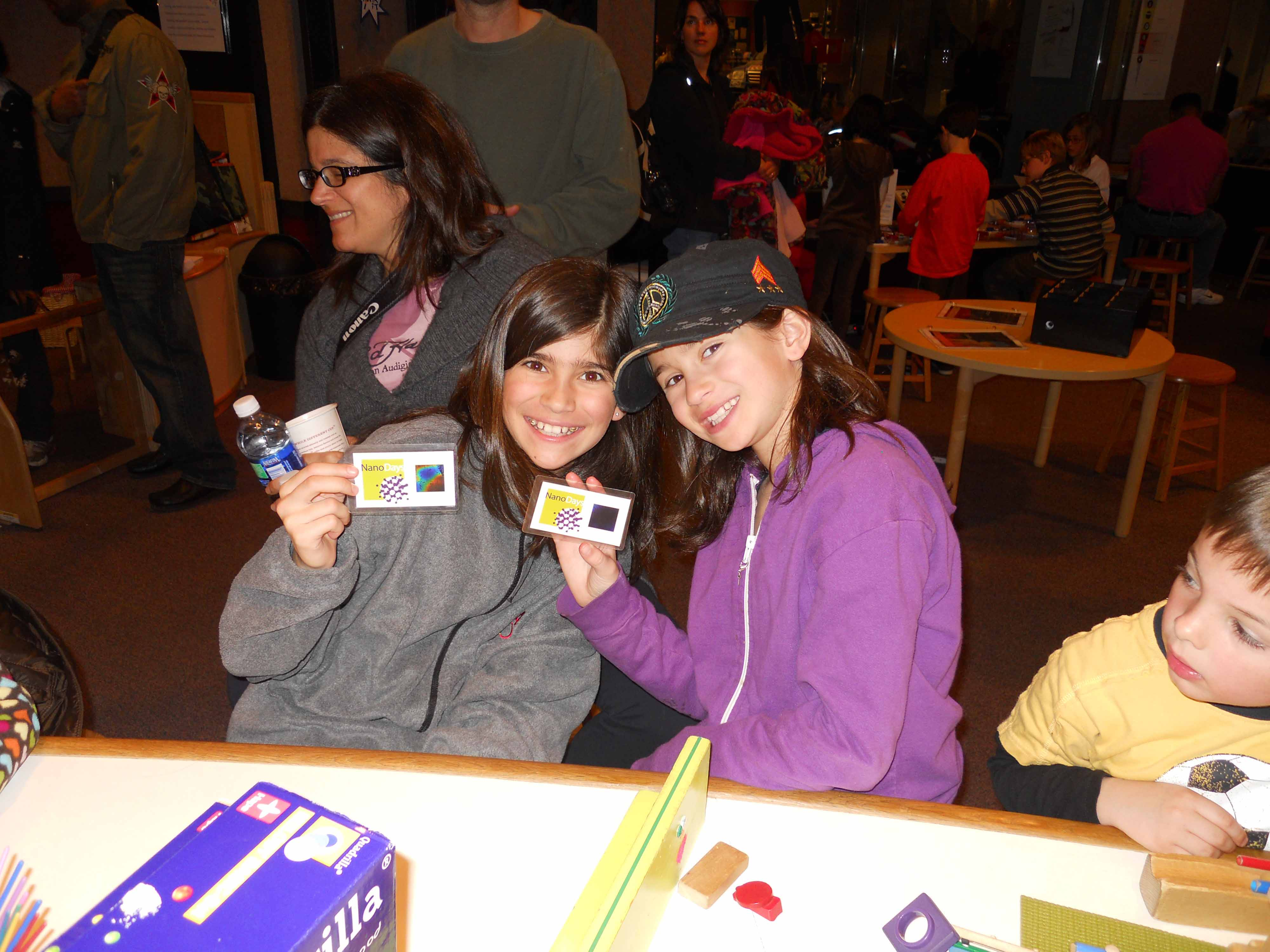 Girls participating in nanotechnology activities in Spark!Lab.