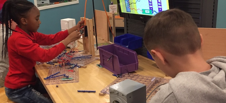 Two young visitors explore the Electrify a Room in Your Home activity in Draper Spark!Lab