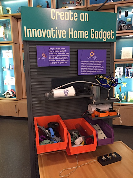 Graphics and materials at the Invent an Innovative Home Gadget activity station