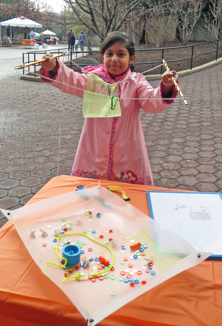 Young girl holding up her invention