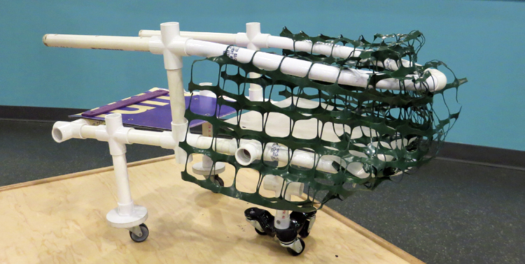 A visitor to SparkLab created a new type of shopping cart by connecting PVC pipes and adding plastic net fencing and three-point wheels, perhaps for improved maneuverability