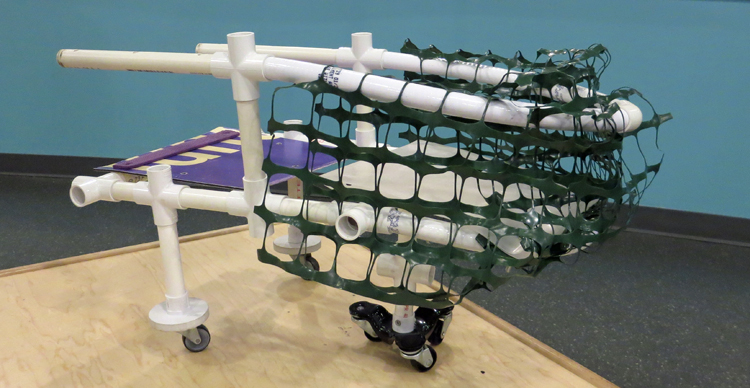 A shopping cart made of PVC pipes, plastic wheels, and plastic net fencing.