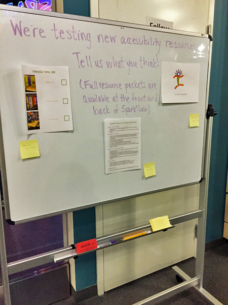 A whiteboard with handwritten request for feedback from visitors