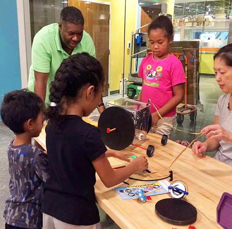 Family at gyroscope activity