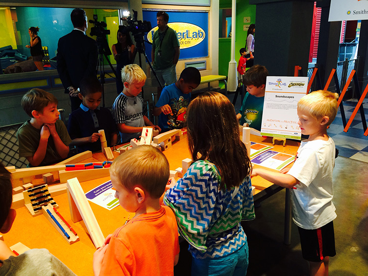 A group of children collaborate on a SparkLab activity at Science City at Union Station, Kansas City