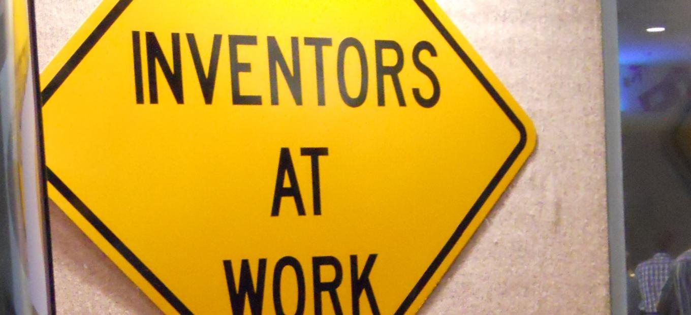 "Traffic sign that reads ""Inventors at Work."""