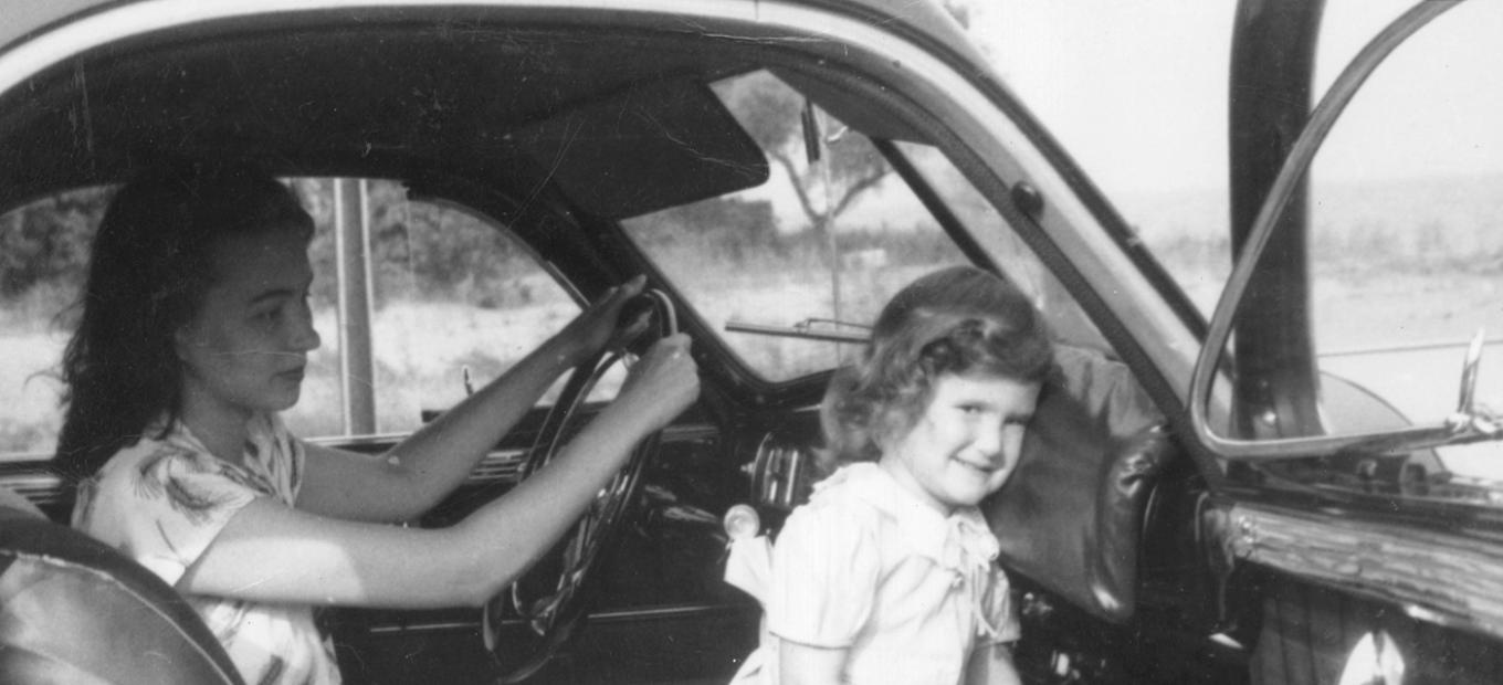 The Straith padded dashboard is demonstrated in this photo by the inventor's daughter, Jean Straith Hepner, and granddaughter, Grace Quitzow.