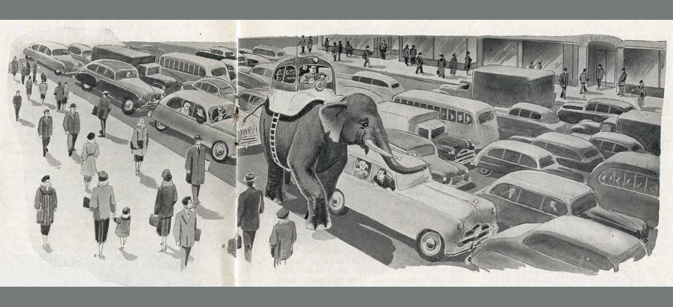 Spoof design for the passenger compartment of a car strapped, complete with driver and steering wheel, atop an elephant, making its way down a crowded city street while amazed pedestrians and other drivers look on.