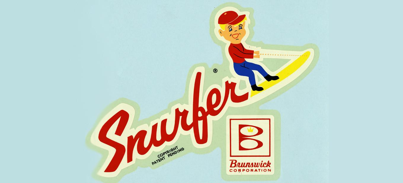 Decal depicting a cartoon boy riding a Snurfer