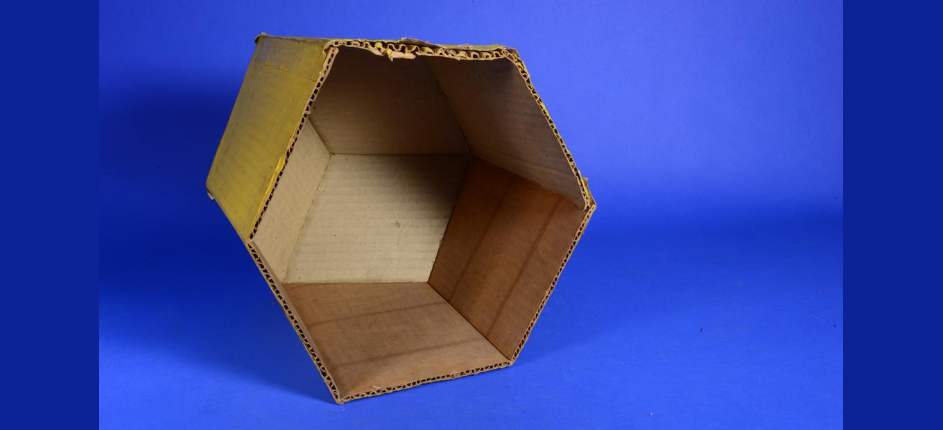 Open bottom of a cardboard model, with corrugation of cardboard visible.