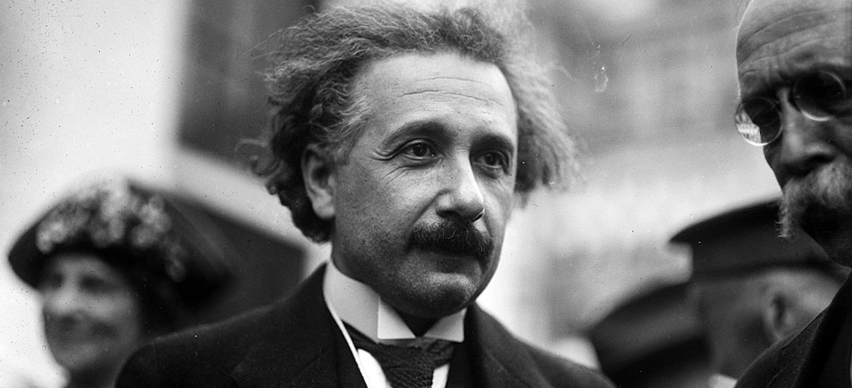 Candid shot of Albert Einstein outside in a crowd