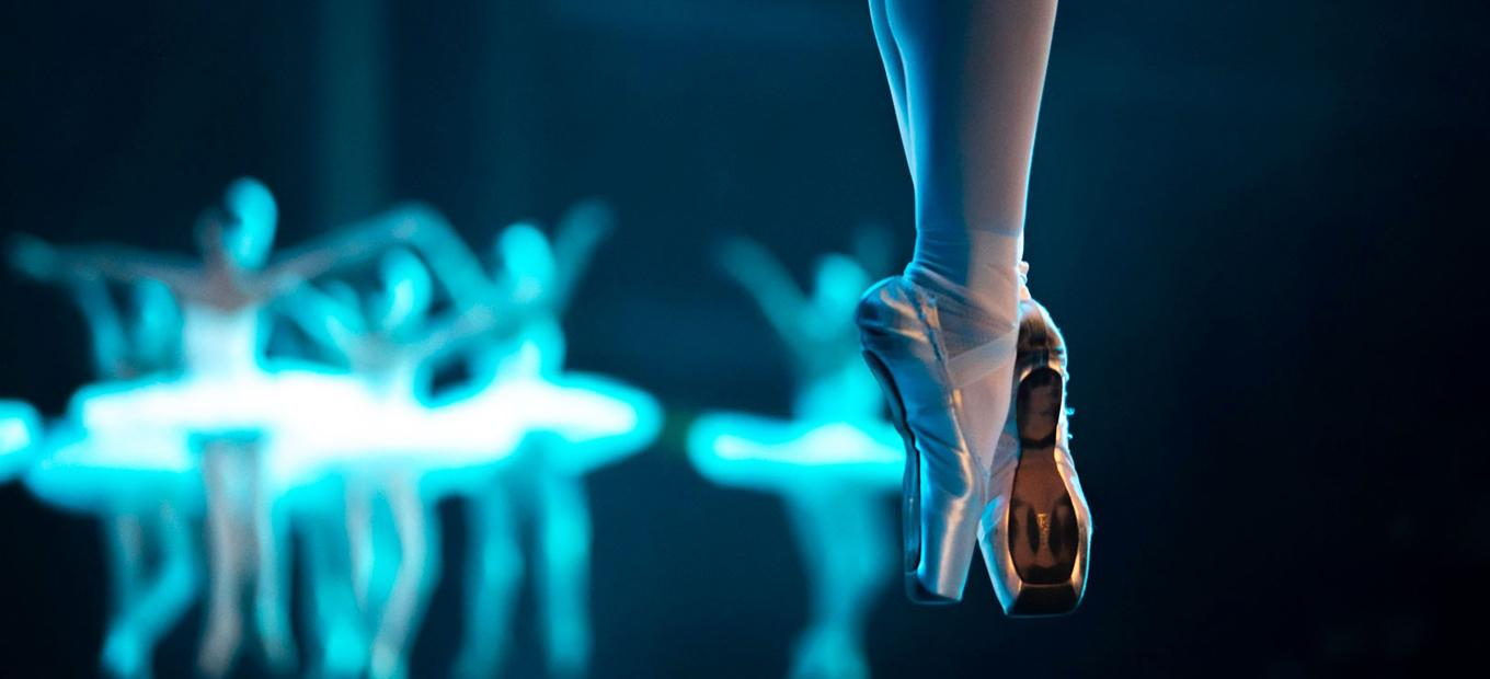 Close-up of a ballerina's feet showing her pointe shoes during a performance of Swan Lake by the Russian Ballet Theatre