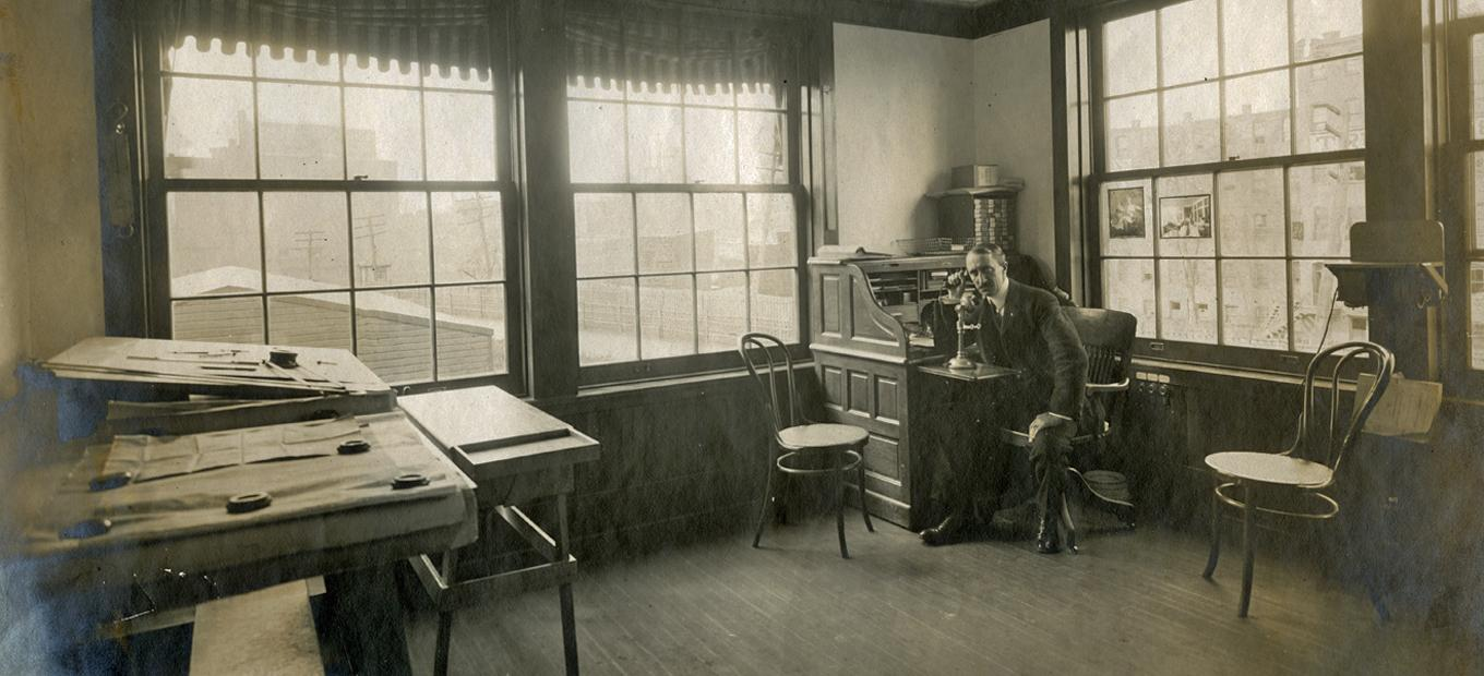 View of Charles Pratts office, with Pratt seated at far right