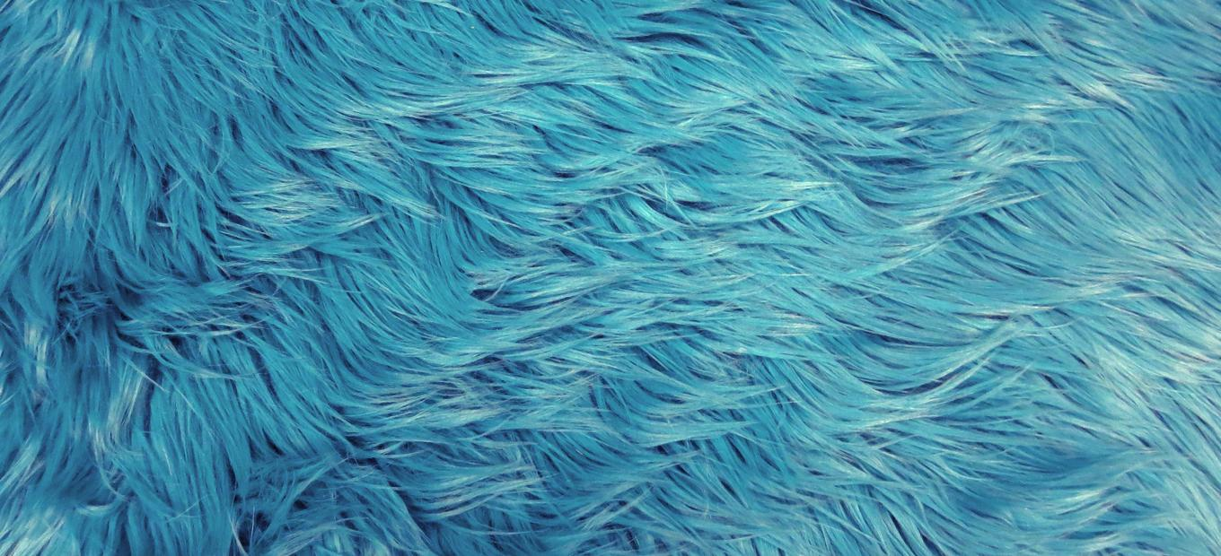 Close-up detail of medium-blue polyester fur