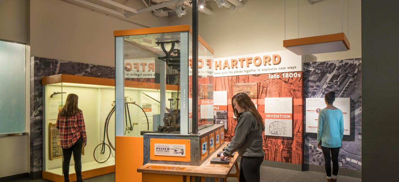 Visitors browse the Hartford, CT section of the Places of Invention exhibition
