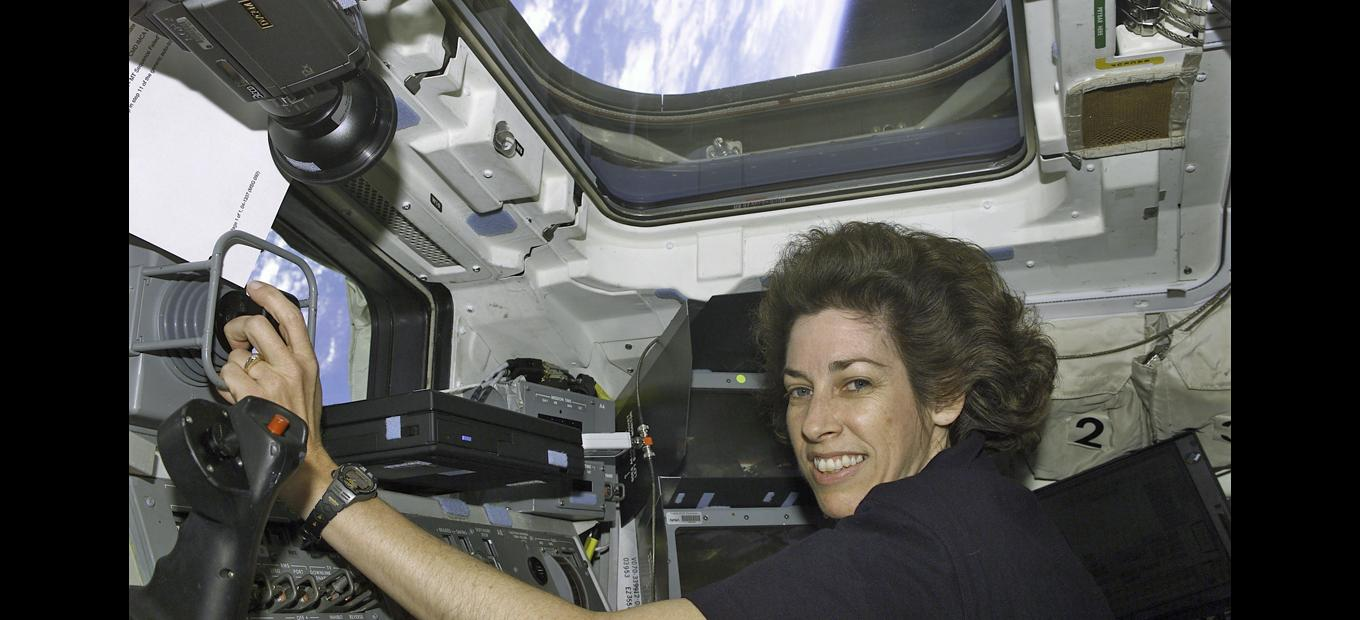 Astronaut Ellen Ochoa on the Atlantis flight deck, 15 April 2002