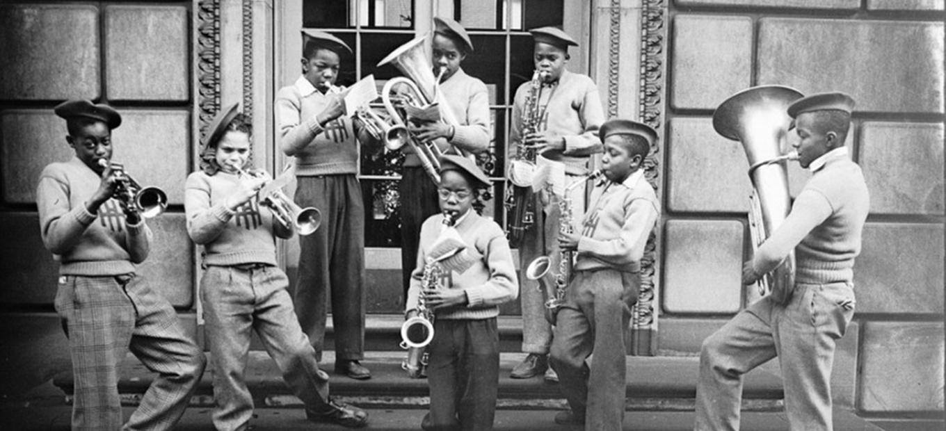"Boys, possibly from Herron Hill School, playing brass instruments on steps, circa 1938-€""1945."