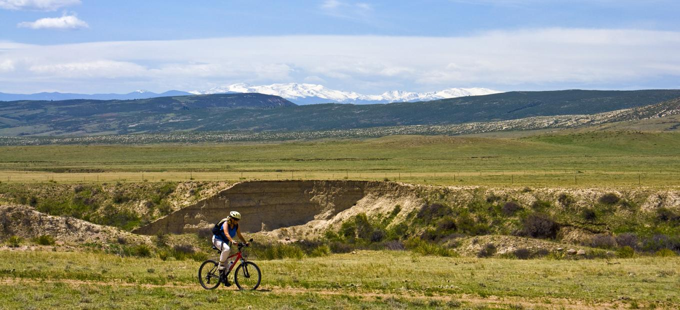A woman rides a bike in Colorado