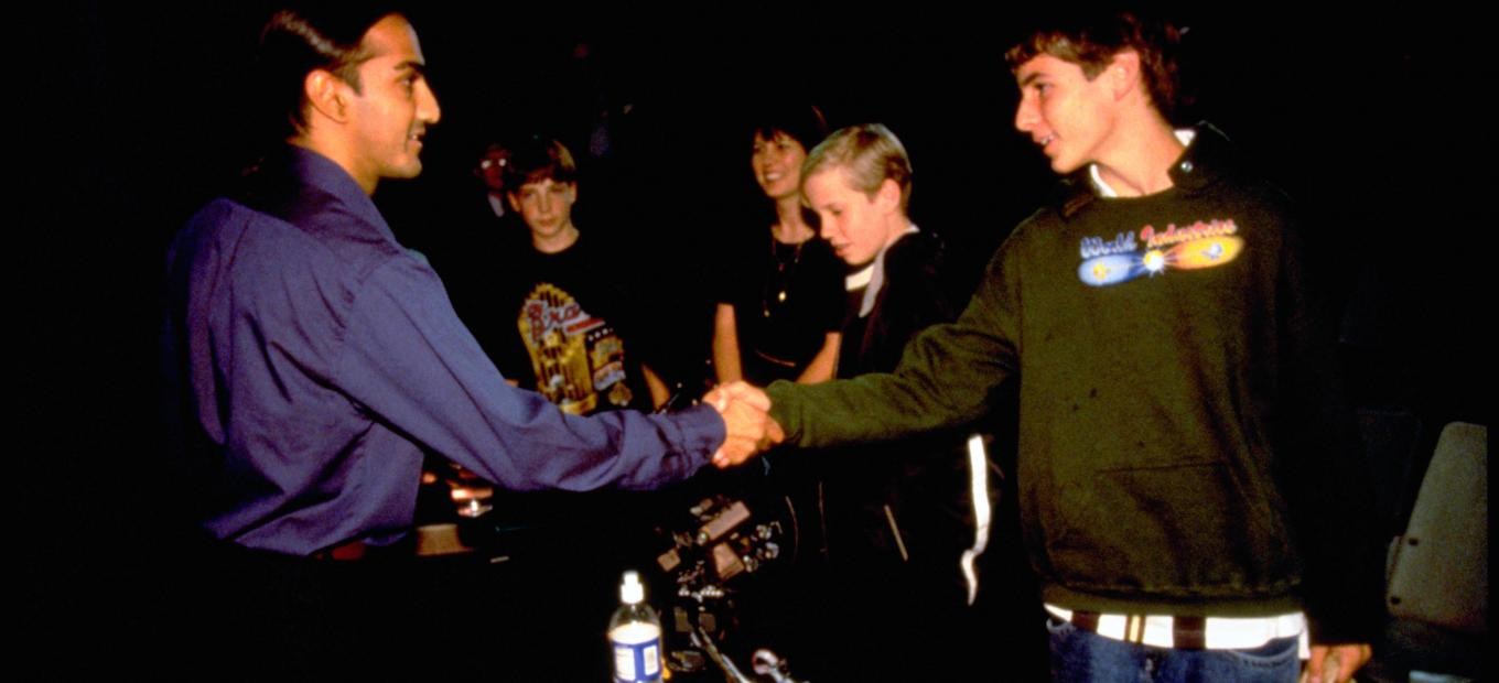 Inventor Akhil Madhani interacts with students during an Innovative Lives presentation