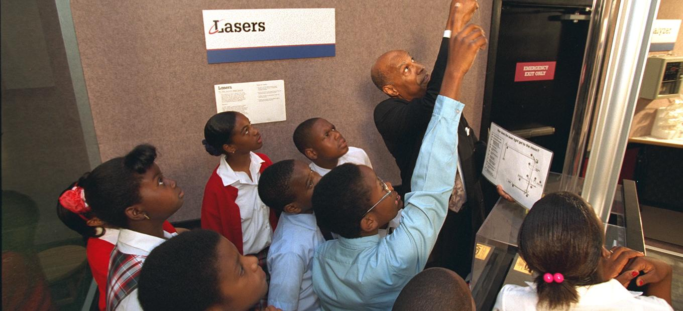 Inventor Hal Walker with students during an Innovative Lives presentation