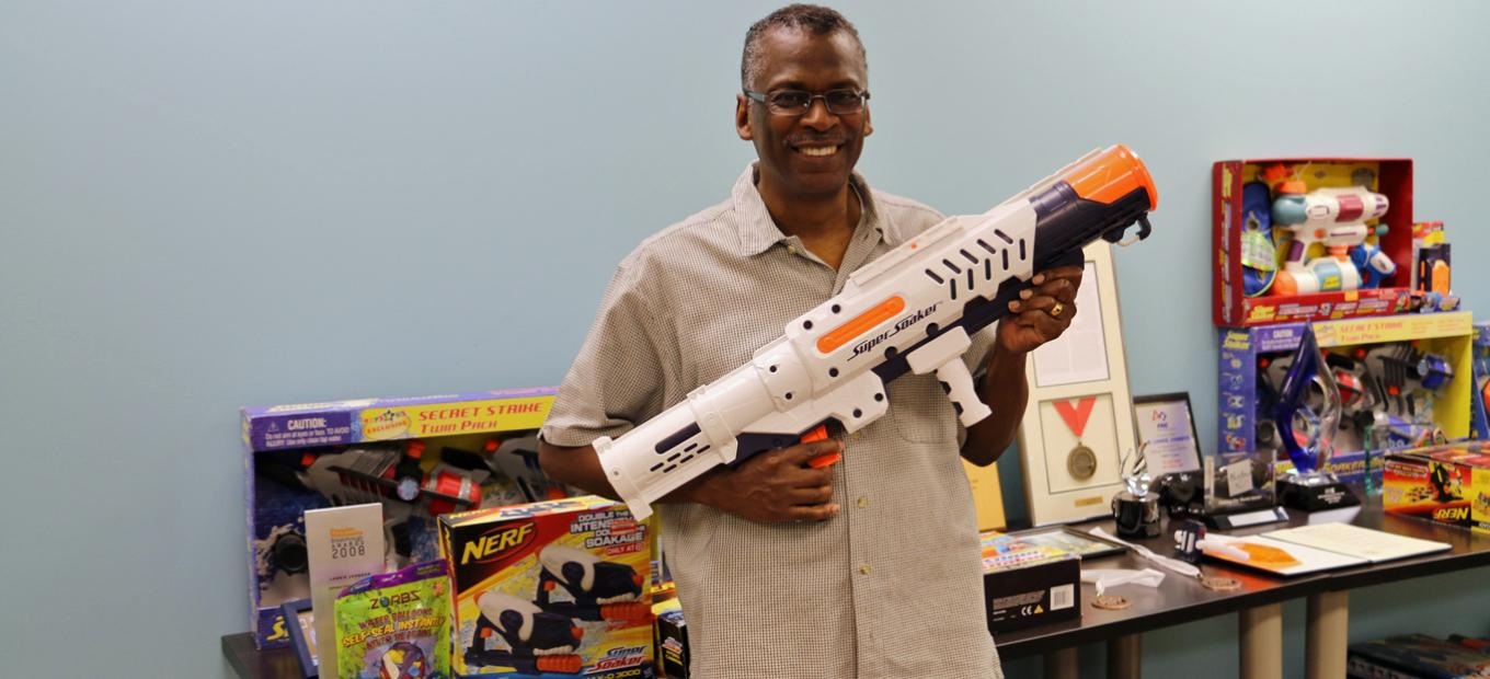 Lonnie Johnson with Super Soaker and Nerf toys