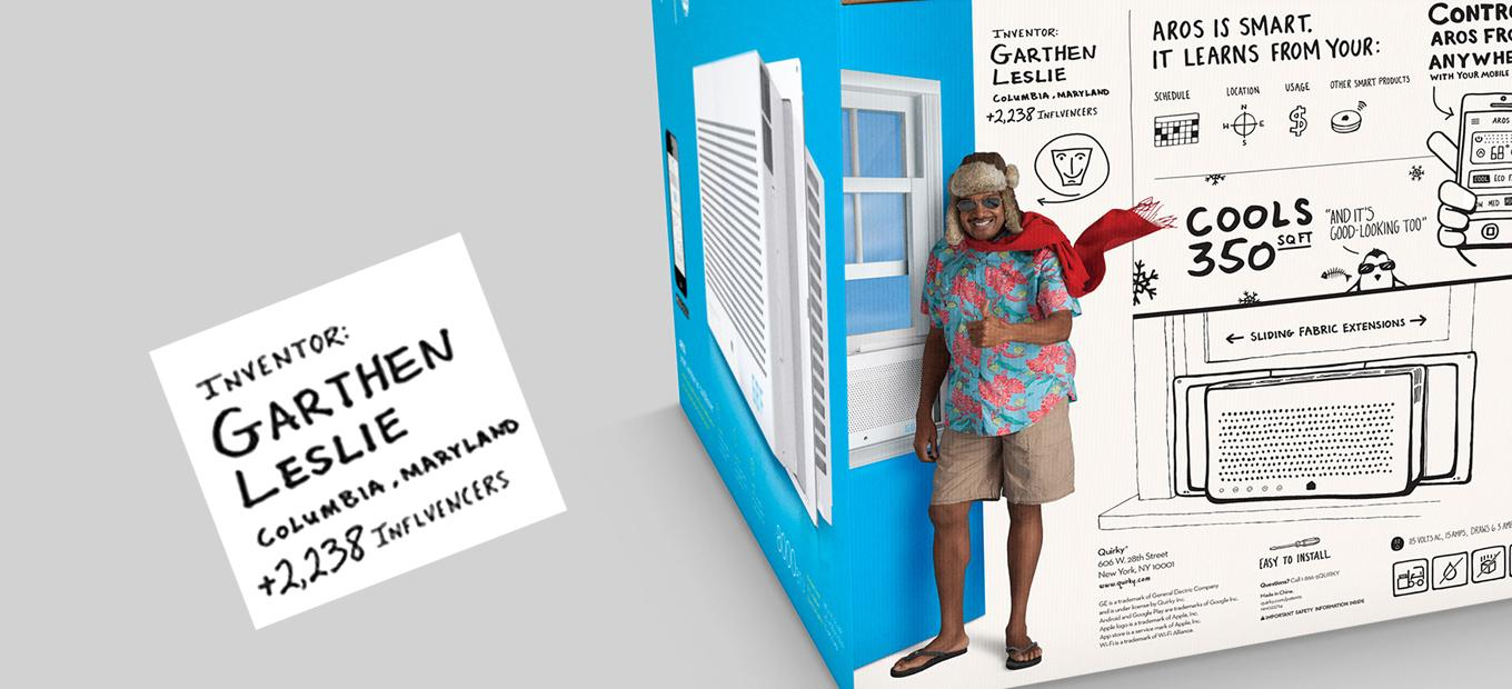 Partial view of Aros air conditioner packing box, featuring an image of inventor Garthen Leslie. He is wearing flip-flops, shorts, a Hawaiian shirt, sunglasses, a scarf, and a furry hat with ear flaps. Drawings on the box describe air conditioner features