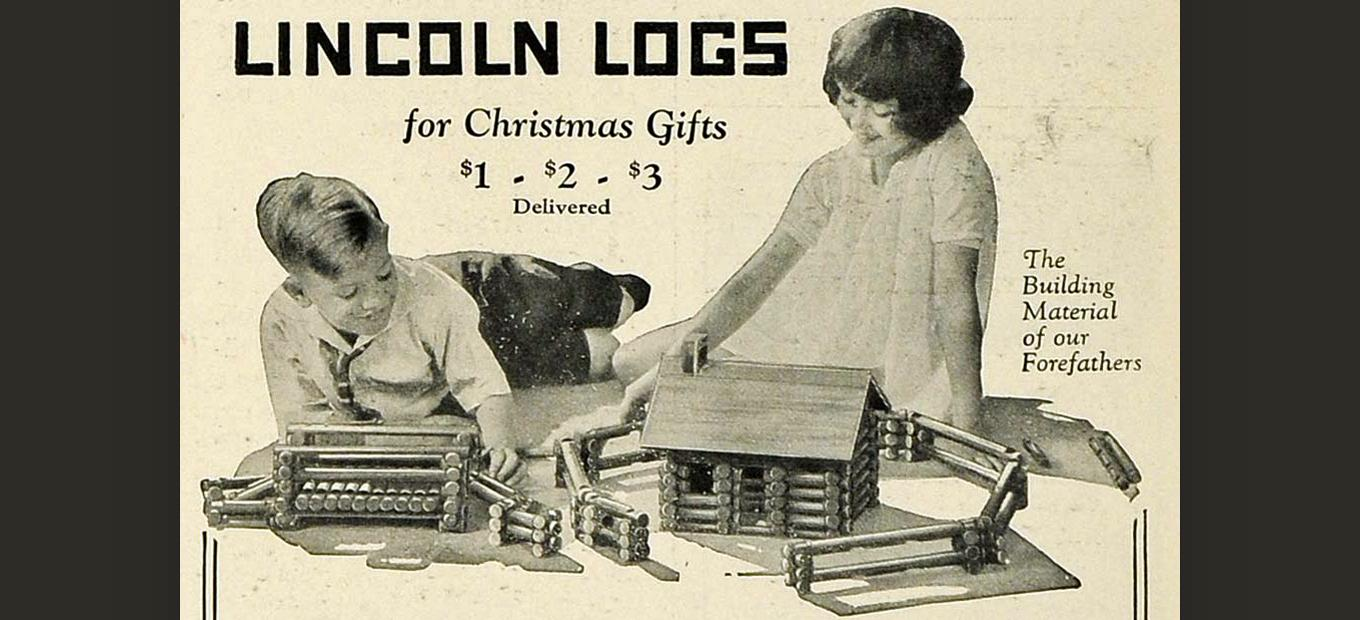 1925 black-and-white print ad for Lincoln Logs, showing a young boy and girl playing with the toy. Caption reads: Lincoln Logs for Christmas Gifts. $1 $2 $3 delivered.