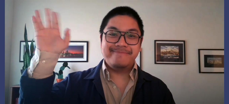 James Santos waving at the camera
