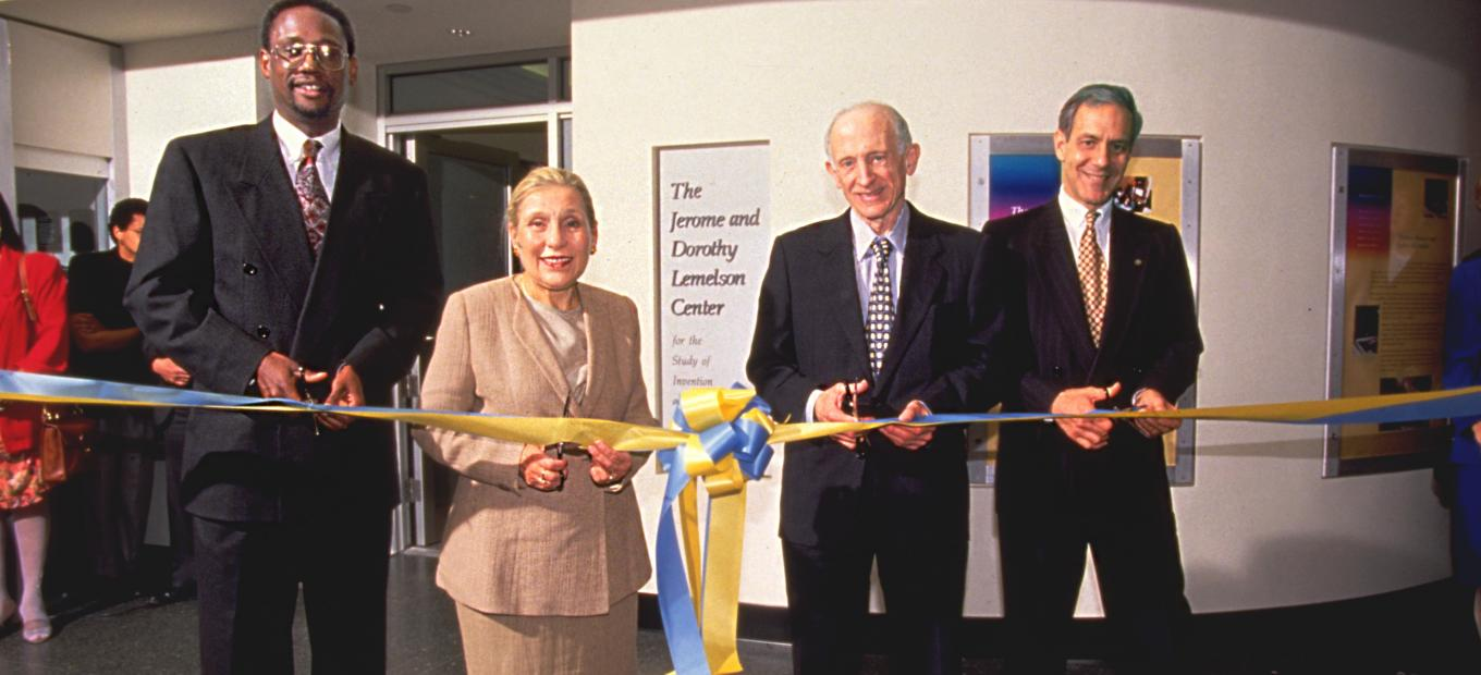 4 people at ribbon cutting ceremony