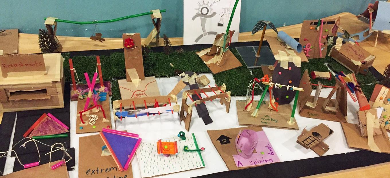 Playground equipment imagined and made by visitors from cardboard and pipe cleaners and other craft materials.