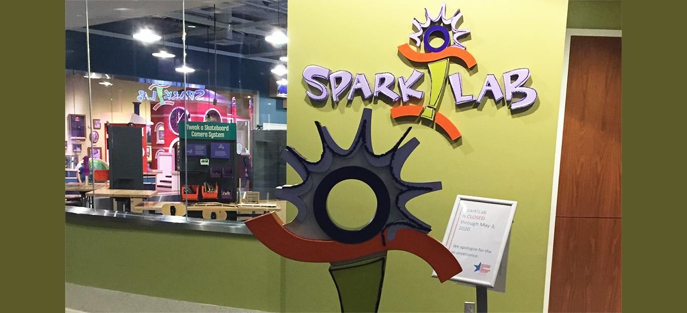 """Looking into the shut-down SparkLab with """"closed"""" sign outside."""
