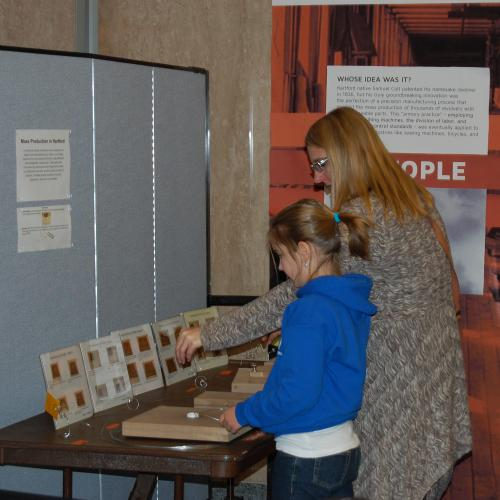 Visitors test an interactive for the Hartford case study in Places of Invention