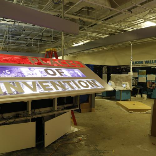 The entry sign to Places of Invention being installed